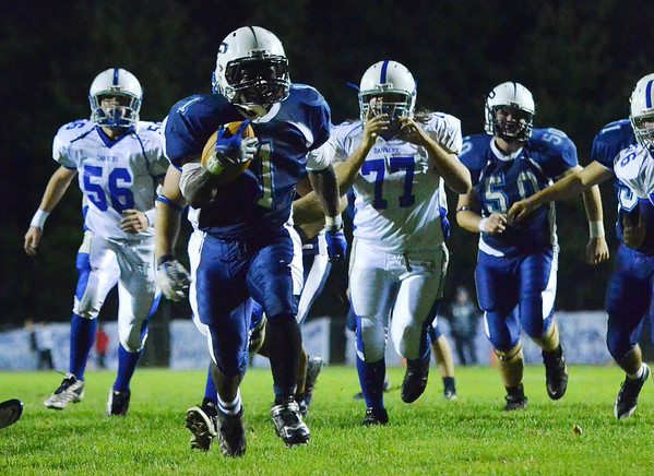 Peabody: Peabody's Nat Gaye runs for a touchdown followed by the Danvers defense.  photo by Mark Teiwes
