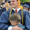 Danvers: At the 100th commencement ceremony at John's Prep, John Logosmasini gets a big hug from his younger brother Matt Lisio.  Photo by Mark Teiwes / Salem News