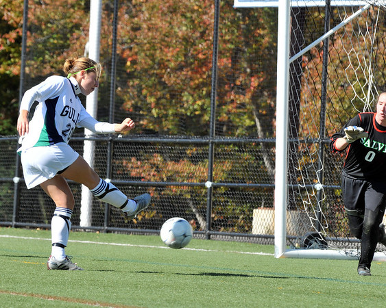 Beverly: Endicott College's Colleen Pepin shoots and scores the first goal during Satudrday's game against Salve Regina.   photo by Mark Teiwes / Salem News