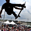 Peabody: One of the many pro skate boarders launches off a half pipe high above the crowds at Journeys Backyard BBQ Tour at Northshore Mall on Saturday.  photo by Mark Teiwes / Salem News