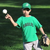Salem: Giovanni Olivera, 7, plays catch before a game. photo by Mark Teiwes / Salem News