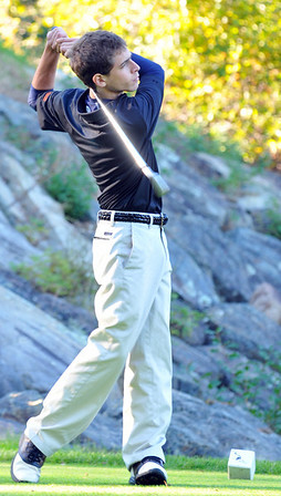 Ipswich:   Ipswich High School golfer Josh Rosenberg, ranked third, finishes a swing teeing off against Rockport and Manchester-Essex at the fifth hole.  photo by Mark Teiwes / Salem News photo by Mark Teiwes / Salem News