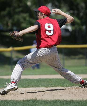 Danvers: Amesbury's relief pitcher Jack Aponas takes aim for a fastball.  photo by Mark Teiwes / Salem News