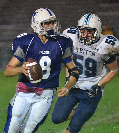 Danvers: Danvers quarterback Paul Nicolo is pursued by Triton's Ryan Clay.  photo by Mark Teiwes / Salem News