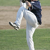 Lynn: Peabody West pitcher Connor Corrigan winds up for a strike.    photo by Mark Teiwes  / Salem News