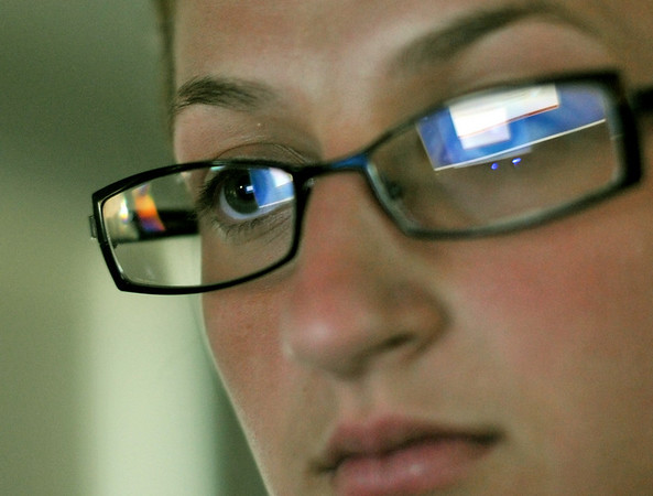 Swampscott High School senior soccer player Carley Hayes takes the ImPact computer test. by Mark Teiwes / Salem News