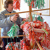 "Hamilton: June Guidara of Danvers adjusts the ""Jul Karamellar"" which are filled with candy to be hung on Christmas trees at the Swedish Yule fair at the community house of Hamilton and Wenham. photo by Mark Teiwes / Salem News"