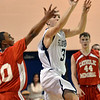 Danvers: St. John's Prep junior Michael Carbone puts up a shot as the buzz rings at the end of the first quarter.  photo by Mark Teiwes  / Salem News