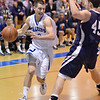 Danvers:  Danvers captain Cormick Powers dribbles around Greater Lowell defender Derek Ross.  photo by Mark Teiwes / Salem News