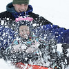 Beverly: 5-year-old Evelyn Treiber plows through deep snow at Lynch Park sledding with her dad Toby Wells of Beverly. photo by Mark Teiwes  / Salem News