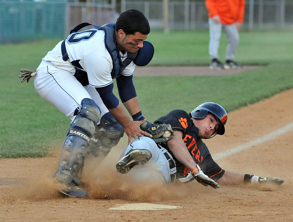 Danvers: Beverly player #5 Mark Theriault gets tagged out at home by Danvers catcher Eric Burgos.  photo by Mark Teiwes / Salem News
