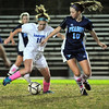 Danvers: Danvers forward captain Brittany Russo dribbles the ball defended by Peabody's Taylor Provost.   photo by Mark Teiwes / Salem News