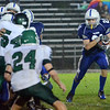 Danvers: Danvers High School football player Alex Valles gets the ball for a run. photo by Mark Teiwes / Salem News