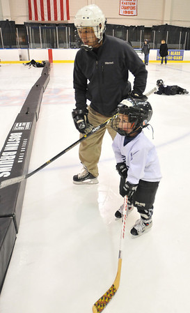 Salem: Tsuyoshi Fukuda of Swampscott teaches his son Matt, 4, to skate.   photo by Mark Teiwes / Salem News