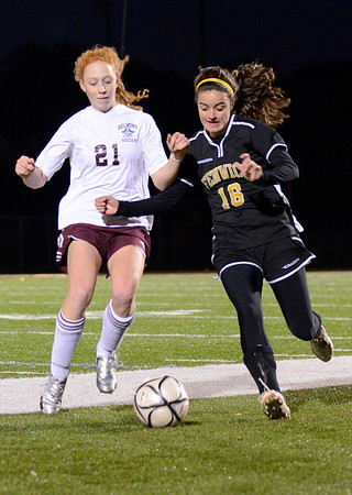 Lynn: Bishop Fenwick's Cate Parrott, right, battles Belmont's Kara Fischer in Division 2 north semifinals.  photo by Mark Teiwes / Salem News