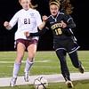 Lynn: Bishop Fenwick's Cate Parrott, right, battles Belmont's Kara Fischer in Division 2 north semifinals.  photo by Mark Teiwes / Salem News