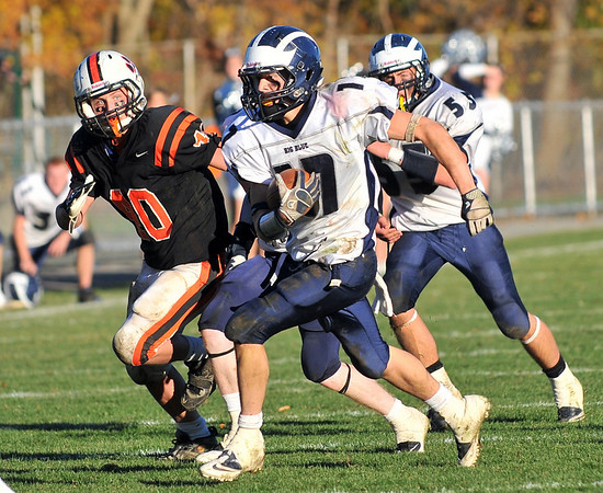 Beverly: Swampscott's Richard Sullivan, right, runs followed by Beverly's Mark Giles. photo by Mark Teiwes / Salem News