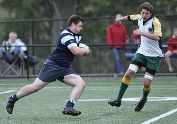 Danvers: St. John's Prep rugby player Chris Laughin returns a kick off followed by the defense of Bishop Hendricken of Rhode Island photo by Mark Teiwes / Salem News