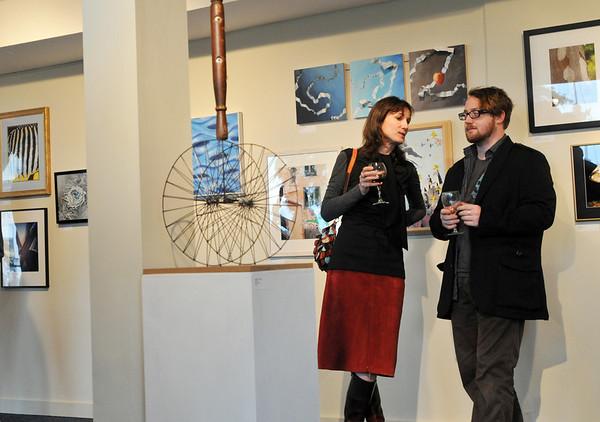 Salem: Susan Stehfast of Salem, left, and Patrick Lochelt of Haverhill chat at a reception for a Salem Arts Association show.   photo by Mark Teiwes / Salem News