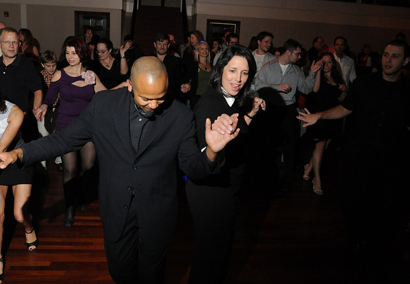 "Salem: Mayor Kim Driscoll, right, dances with instructor Greg Coles at last night's ""Salsa for the Schools"" fundraising event at Rockafella's. photo by Mark Teiwes / Salem News"