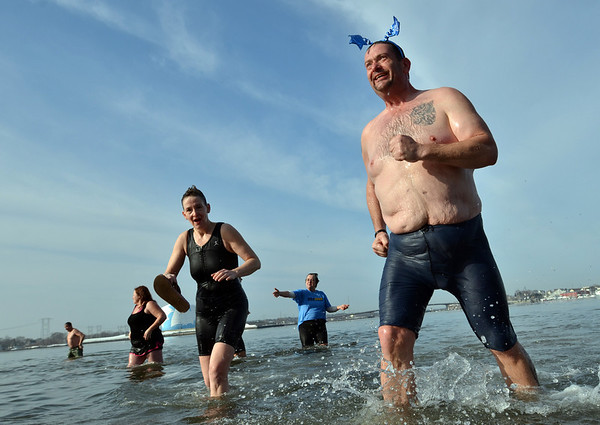 """Salem: Participants take part in the second annual """"Freeze Your Tush Off"""" ocean dip at Dead Horse Beach.   photo by Mark Teiwes  / Salem News"""