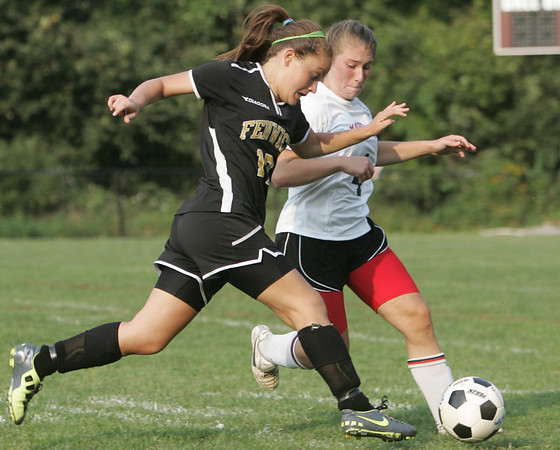 Marblehead: Bishop Fenwick's Vicky Caruso, left, fights for the ball with Marblehead's Gabby Carrick in a 3-3 tie.  photo by Mark Teiwes / Salem News