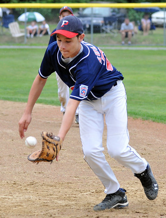 Woburn:  Peabody West player Bobby Sullivan makes an infield stop and out to end the inning. photo by Mark Teiwes / Salem News