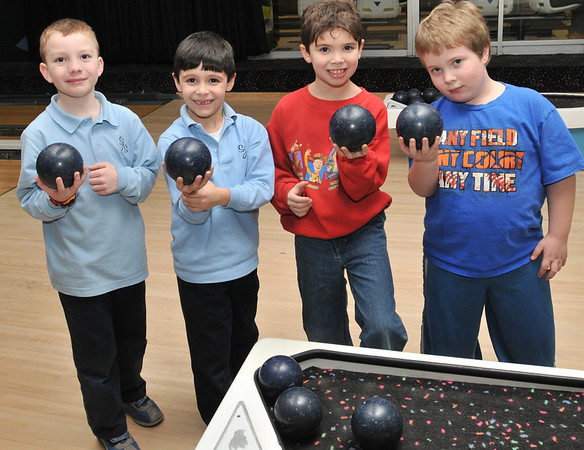 Peabody: For over 30 years Metro Bowl has hosted a children's league.  Pictured from left, St. John's first graders Kyle Hughes, and Austin Medico, and Thomas Carroll School first grader Adam Lantych, and Garrett Lezott, Center School second grader. photo by Mark Teiwes  / Salem News