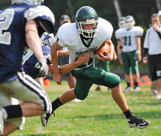 Hamilton: Pentucket's Paul Treado runs for a gain through Hamilton-Wenham's defense.  photo by Mark Teiwes / Salem News