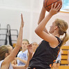 Danvers:  Beverly's Bridget Keaton drives to the hoop at a North Shore Summer Basketball League girls playoff game.  photo by Mark Teiwes /  Salem News