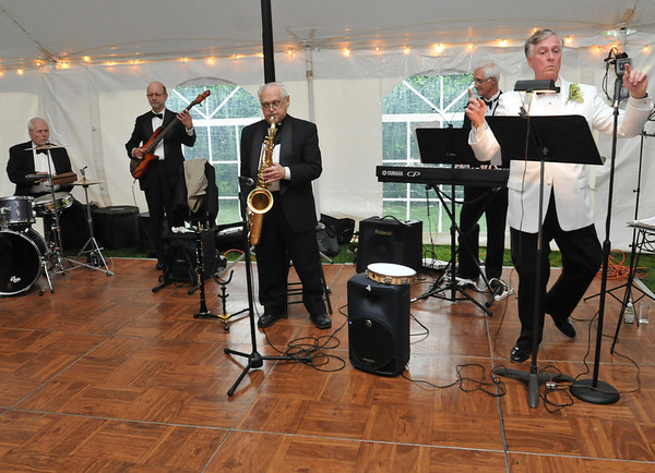 Danvers: The Just in Time band, led by John Archer, right, play at the Baron Mayer Award champagne reception.  photo by Mark Teiwes / Salem News