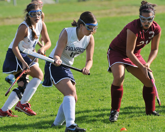 Swampscott: Swampscott junior field hockey midfielder, Ali Aylward, center, puts a shot on the goal in a game against Glocuester.    photo by Mark Teiwes / Salem News