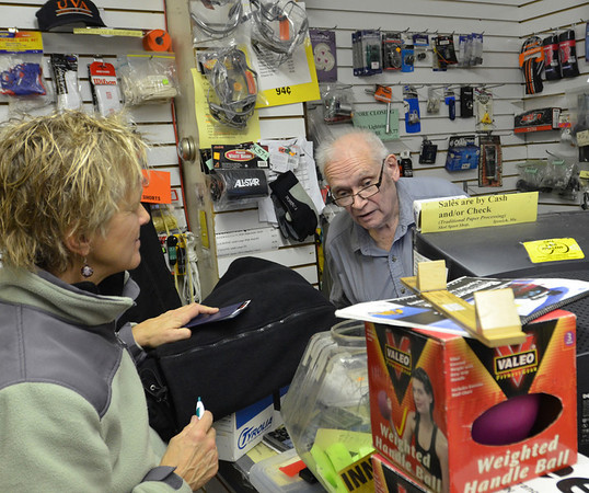 Ipswich: Tammy Murawski, left, who grew up in Ipswich, remembers when she came to rent the store's tandem bike as a kid.  Henry Rolfe, right, has worked at the shop since the 1980's.  photo by Mark Teiwes  / Salem News