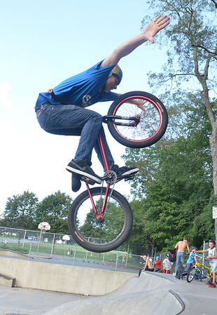 Peabody: Dom Carpinelli, 14, of Peabody performs a tuck no handle trick at the Tanner City Skate Park photo by Mark Teiwes / Salem News