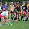 Peabody:  Pam Grant, Peabody High School field hockey team's new head coach, talks mechanics with the team at practice.  photo by Mark Teiwes / Salem News