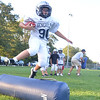 Hamilton:  Erik Fotta, 10, leaps during a drill at a Hamilton-Wenham Youth Football practice.   photo by Mark Teiwes / Salem News
