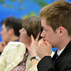 Wenham: Brad Kippen, a student representative at the school committee meeting, listens as Superintendent Raleigh Buchanan proposes class during February break.  photo by Mark Teiwes / Salem News