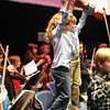 Beverly: Kaj Avola, left, and Dylan Hickey stand in triumph after performing with the Beginner Strings ensemble at the Beverly Public Schools Winter orchestra concert.    photo by Mark Teiwes / Salem News
