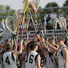 Ipswich: Ipswich girls lacrosse team cheers before the start of the first half.  photo by Mark Teiwes / Salem News