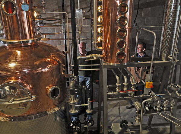 Ipswich:  Nelse Clark, left, and Andrew Cabot have started a rum and whiskey-making business.  They have just installed their distillers, fermenters and other equipment in a warehouse in Ipswich and their first product will be ready over the summer.   photo by Mark Teiwes / Salem News