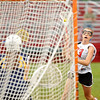 Marblehead: Marblehead's Courtney Maag drives to the goal for a shot.  She scored the winning goal at the end of the game for a Marblehead win over Arlington Catholic 10-9.  photo by Mark Teiwes / Salem News