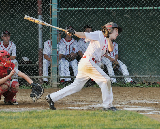 Salem: Marblehead's James McCarthy follows through on a base hit in the finals of the Gallant Tournament versus Lynn. photo by Mark Teiwes /  Salem News