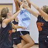 Danvers:  Danvers player Delany Zecha makes a layup surrounded by Beverly defenders at a North Shore Summer Basketball League girls playoff game.  photo by Mark Teiwes /  Salem News