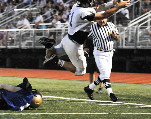 Lynn: Marblehead's Hayes Richardson dives into the end zone for a touchdown at the 49th annual Agganis All-Staff Football Classic.  photo by Mark Teiwes / Salem News