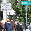 Salem: People congregate to see the new road sign after a ceremony renaming Bridge Street Bypass to Sergeant James Ayube II Memorial Drive.   photo by Mark Teiwes / Salem News