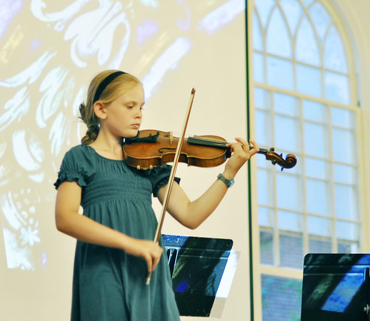 Salem: 11-year-old Susanna Monroe plays a European music piece.  photo by Mark Teiwes / Salem News