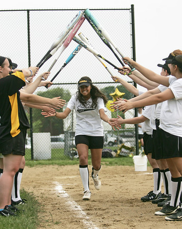 Peabody: Bishop Fenwick senior Christine Smaltz comes through a bridge of bats before a game against Cardinal Spellman.  photo by Mark Teiwes / Salem News