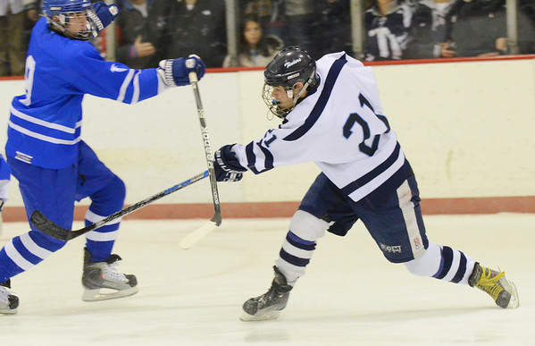 Peabody: Peabody's Jack McCarthy rifles off a shot on goal.  photo by Mark Teiwes  / Salem News