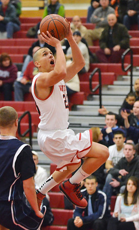 Salem: Salem's Dario Merano drives to the hoop during last night's game against Peabody.  photo by Mark Teiwes  / Salem News