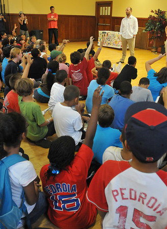 Salem:  Red Sox second baseman Dustin Pedroia, right, answers questions  from chldren at Boys & Girls Club of Greater Salem.  photo by Mark Teiwes / Salem News